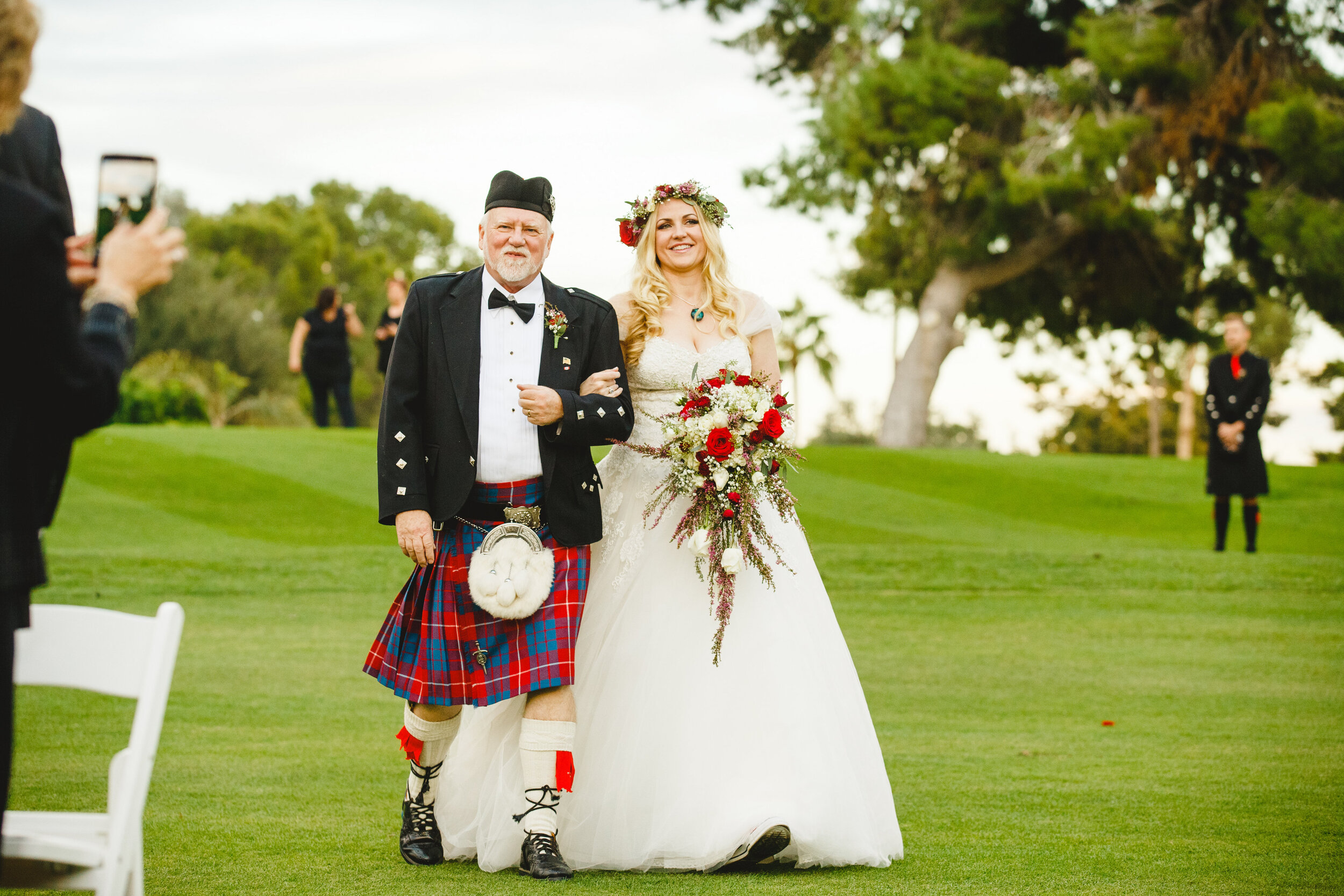 Alternative bride walking down the aisle with father wearing traditional Scottish outfits Kilt Scottish styled wedding.jpg