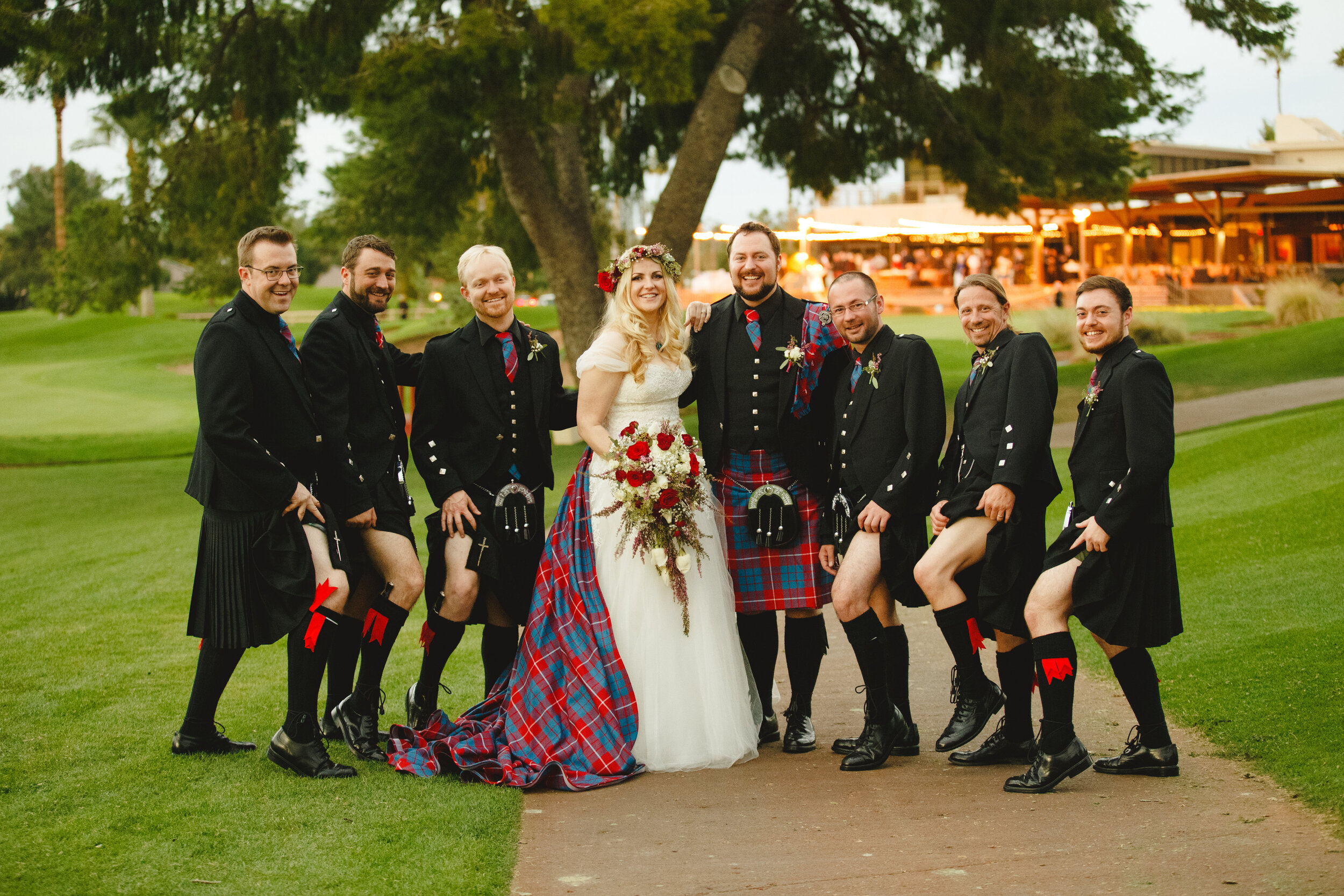 Alternative bride with tartan train with groomsmen wearing kilt highland dress at her cultural alternative wedding.jpg