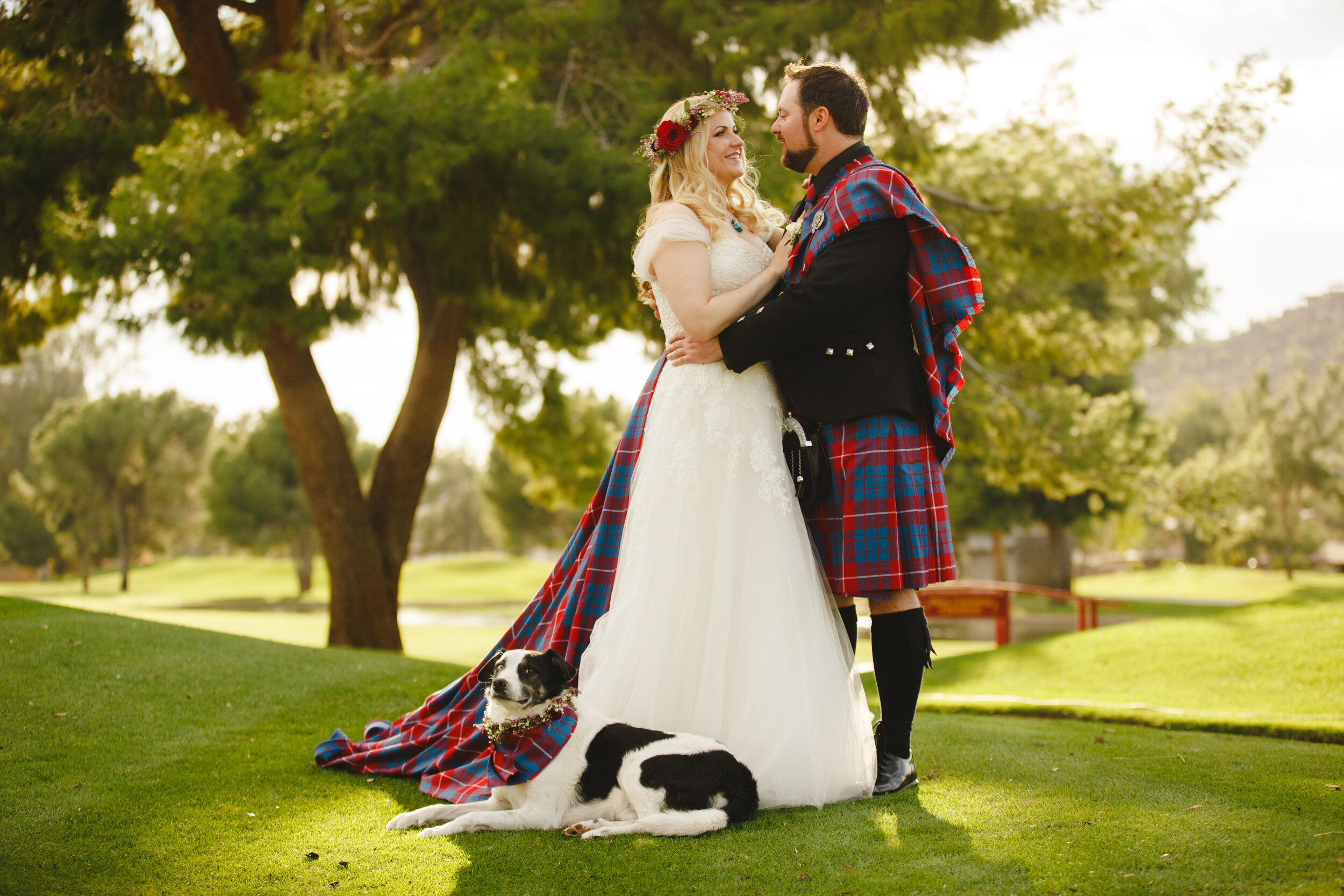 Bride and groom in highland kilt dress and a dog embracing Scottish heritage in their wedding with handmade Scottish tartan.jpg
