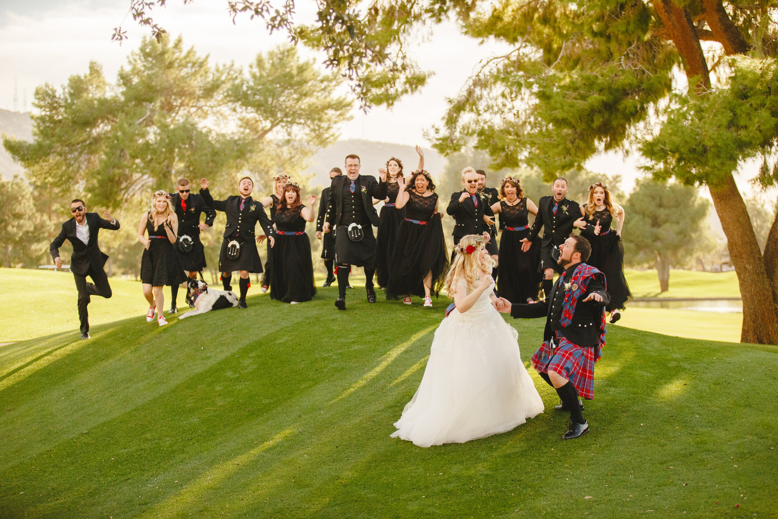 Bride and groom Scottish cultural themed alternative wedding with bridesmaids and groomsmen in black outfits.jpg