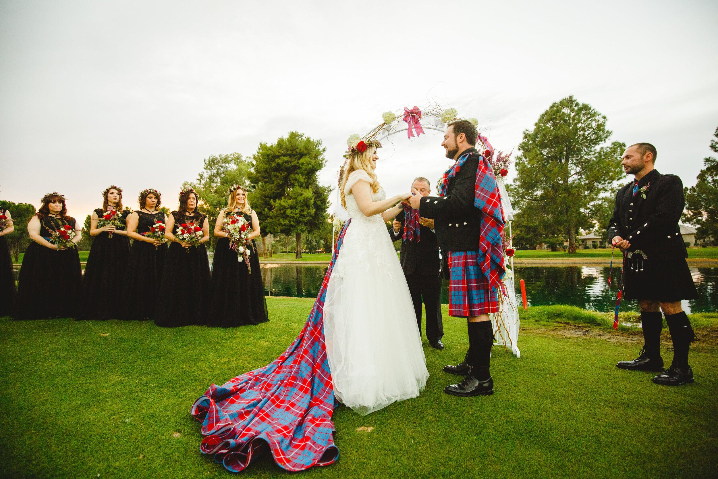 At cultural wedding, alternative bride wearing a redesigned wedding dress with Scottish cultural tartan train.jpg