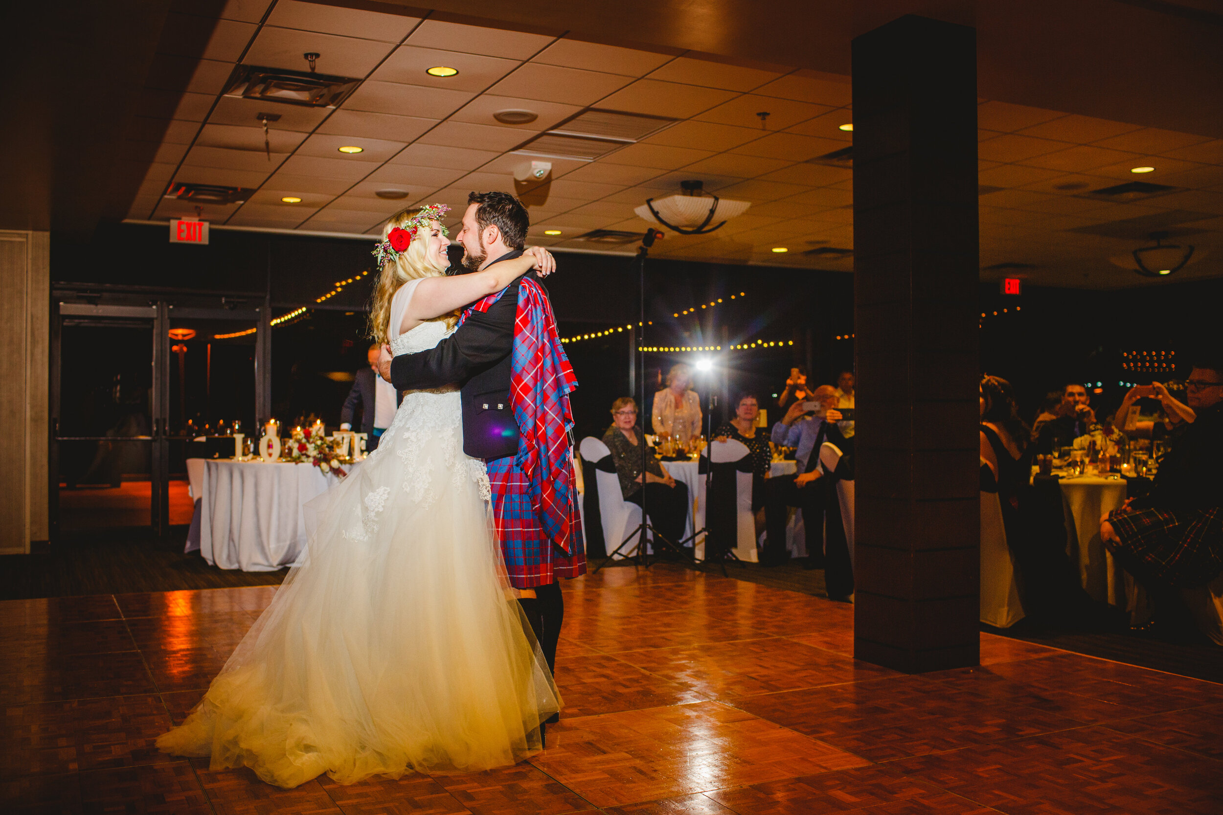 First dance at the reception groom in kilt highland dress and alternative bride with detachable tartan train.jpg