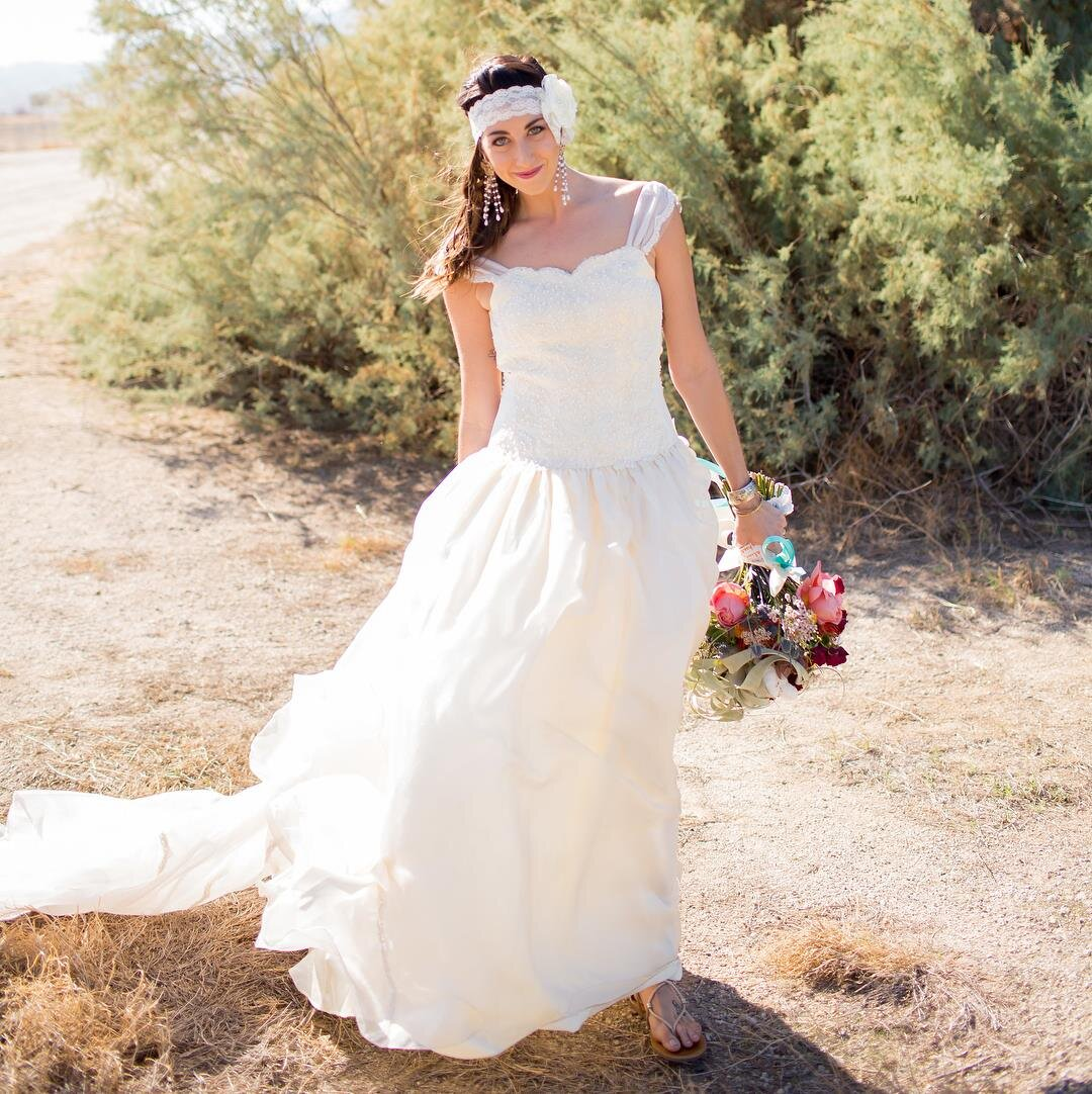 Alternative bride wearing restyled vintage grandmother of the bride wedding dress with lace bridal headpiece .jpg