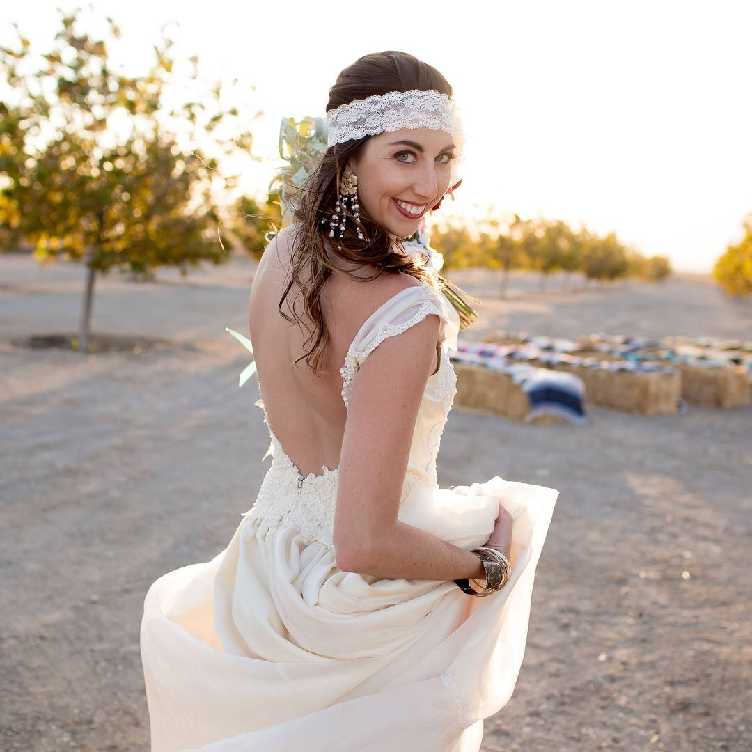 Vintage bride wearing restyled open back grandmothers wedding dress with lace headpiece.jpg