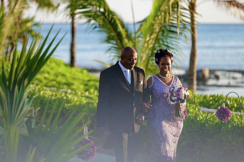 Alternative bride wearing nontraditional purple wedding dress accented with pearls for resort wedding.jpg