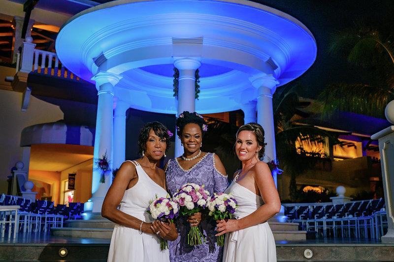 Bespoke bride in purple wedding dress with bridesmaids with flower bouquets.jpg