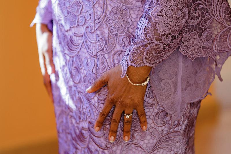 Bride wearing custom designed lavender long sleeved wedding dress with engagement ring.jpg