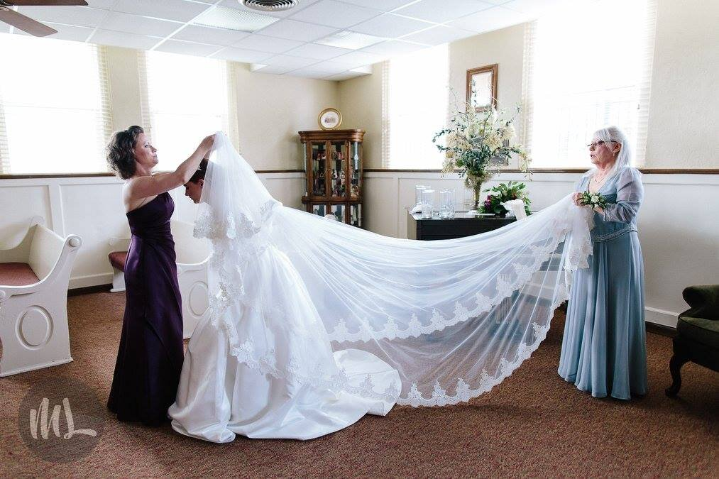 Custom made cathedral veil with French lace trim put by mother of the bride.jpg