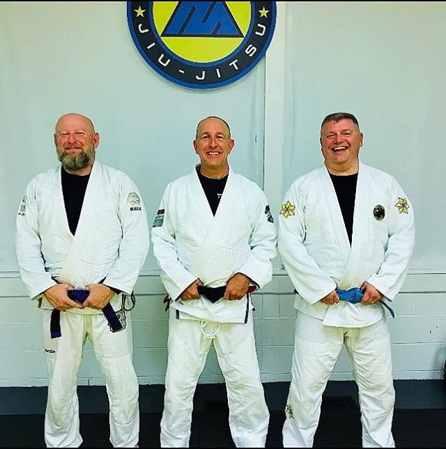 Congrats to James on his promotion to Blue Belt and Scott on his promotion to Purple Belt! These are two martial arts veterans and there's close to 90 years of mat time in this picture.