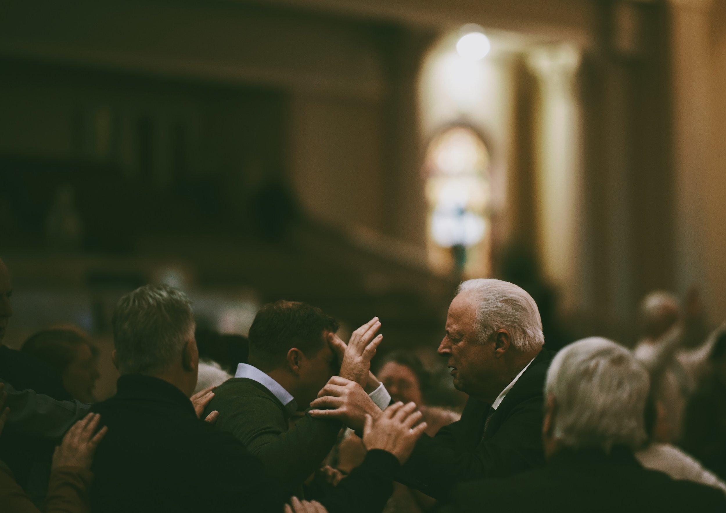 PH Praying for Saint.JPG
