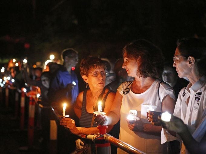 """Over a 100 New Yorkers line up in front of Gov. Andrew Cuomo's residence for a """"Candles for Clemency"""" vigil, Sept. 6, 2014 in New Castle. Supporters are urging Gov. Andrew Cuomo to grant clemency to even one of the 55,000 men and women imprisoned in New York State. Tania Savayan/The Journal News"""