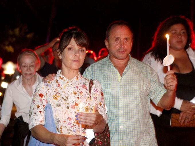 """Kathryn Erbe from Law and Order: Criminal Intent and Allen Roskoff, President of the Jim Owles Liberal Democratic Club, lead a """"Candles for Clemency"""" walk towards Gov. Andrew Cuomo's residence, Sept. 6, 2014 in New Castle. Over a 100 New Yorkers gathered for the vigil to urge Gov. Andrew Cuomo to grant clemency to even one of the 55,000 men and women imprisoned in New York State. Tania Savayan/The Journal News"""