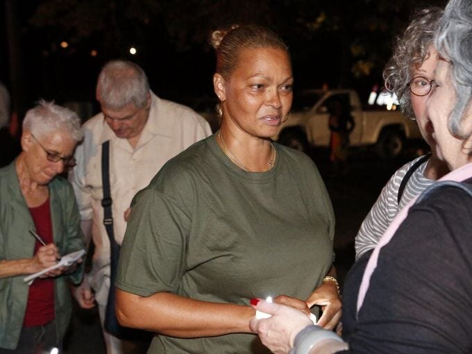 """Donna Hylton, 49, of Brooklyn who spent 27 years at Bedford Hills Correctional Facility, attends a """"Candles for Clemency"""" vigil near Gov. Andrew Cuomo's residence, Sept. 6, 2014 in New Castle. Supporters are urging the governor to grant clemency to even one of the 55,000 men and women imprisoned in New York State. Tania Savayan/The Journal News"""