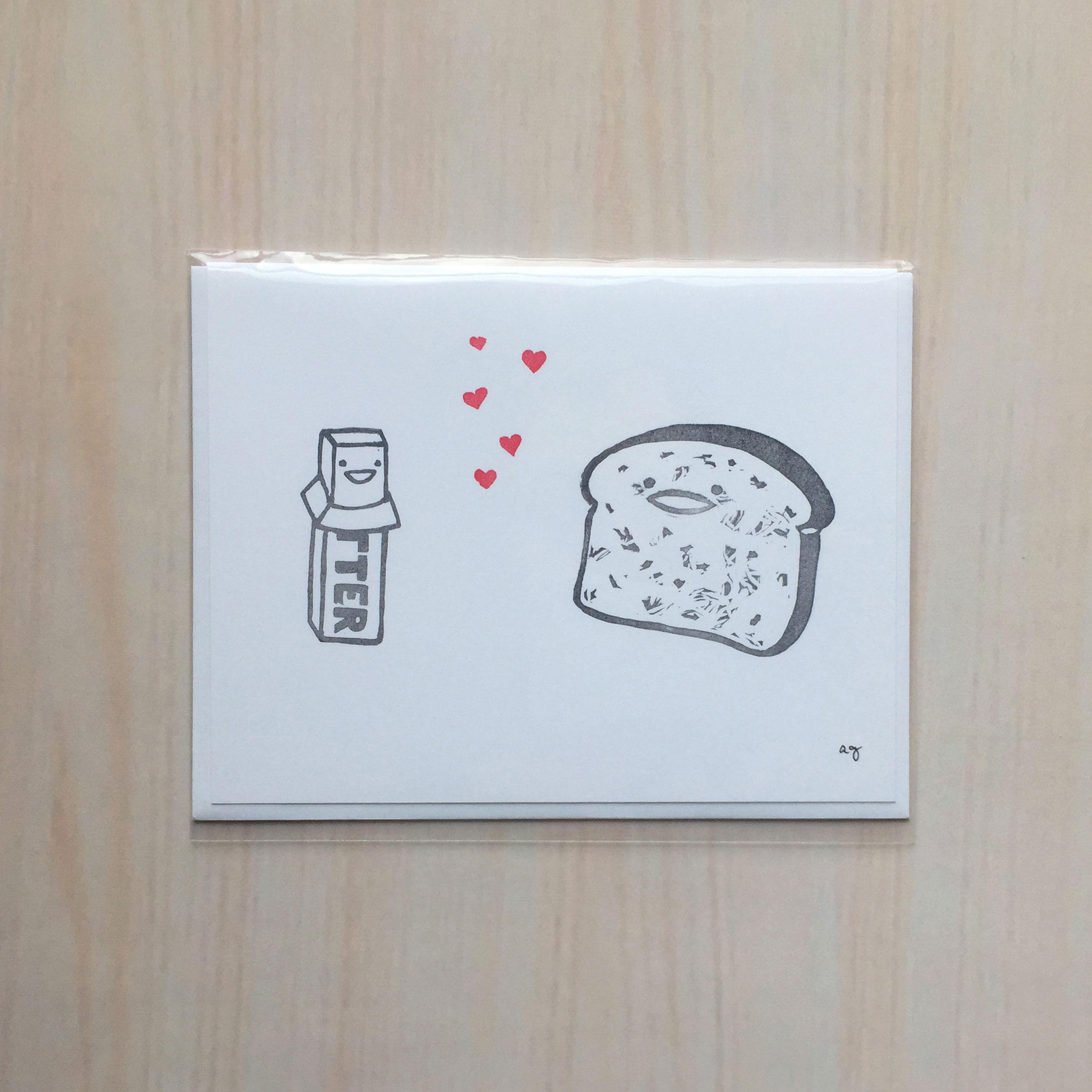 "Butter Loves Toast   Size: 4""x5"" Printing: block print Inside: blank Envelope: white"