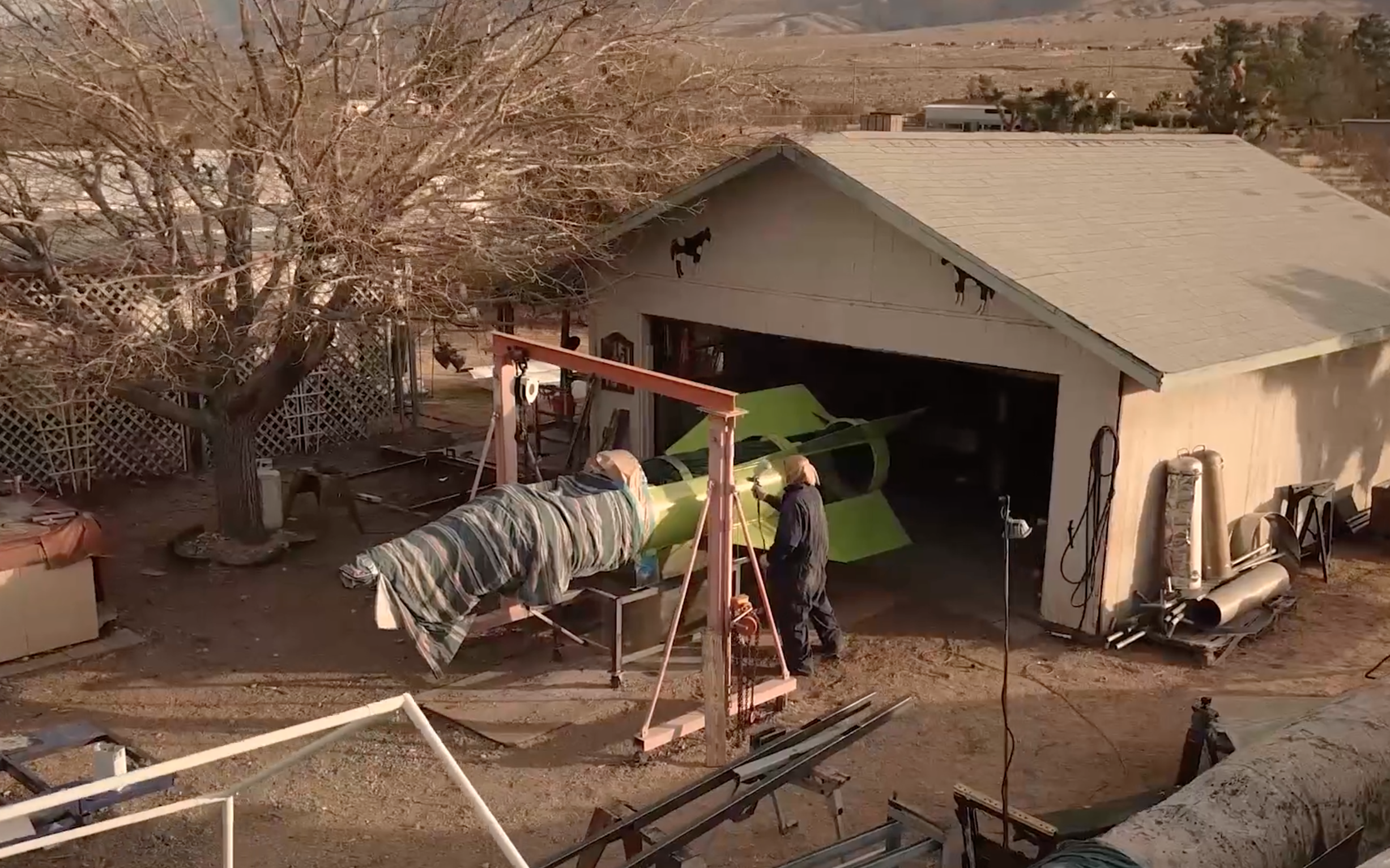 'Mad Mike' paints the rocket at his home in Apple Valley, CA.