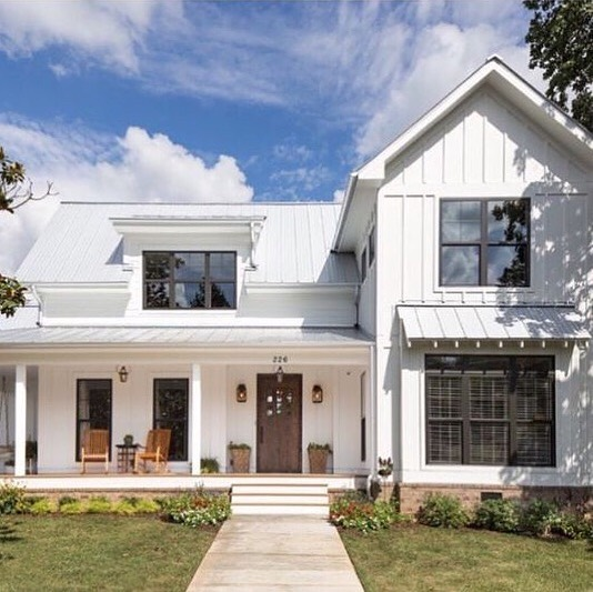 It seems we just can't get away from the classic style farmhouse for our house. This beauty by @jtaylordesigns has been on our radar for a while. We love the different pitched roofs, exposed rafters in specific areas, and the inviting porch. All things we're looking for in our house. #designinspo #farmhouse #porchenvy