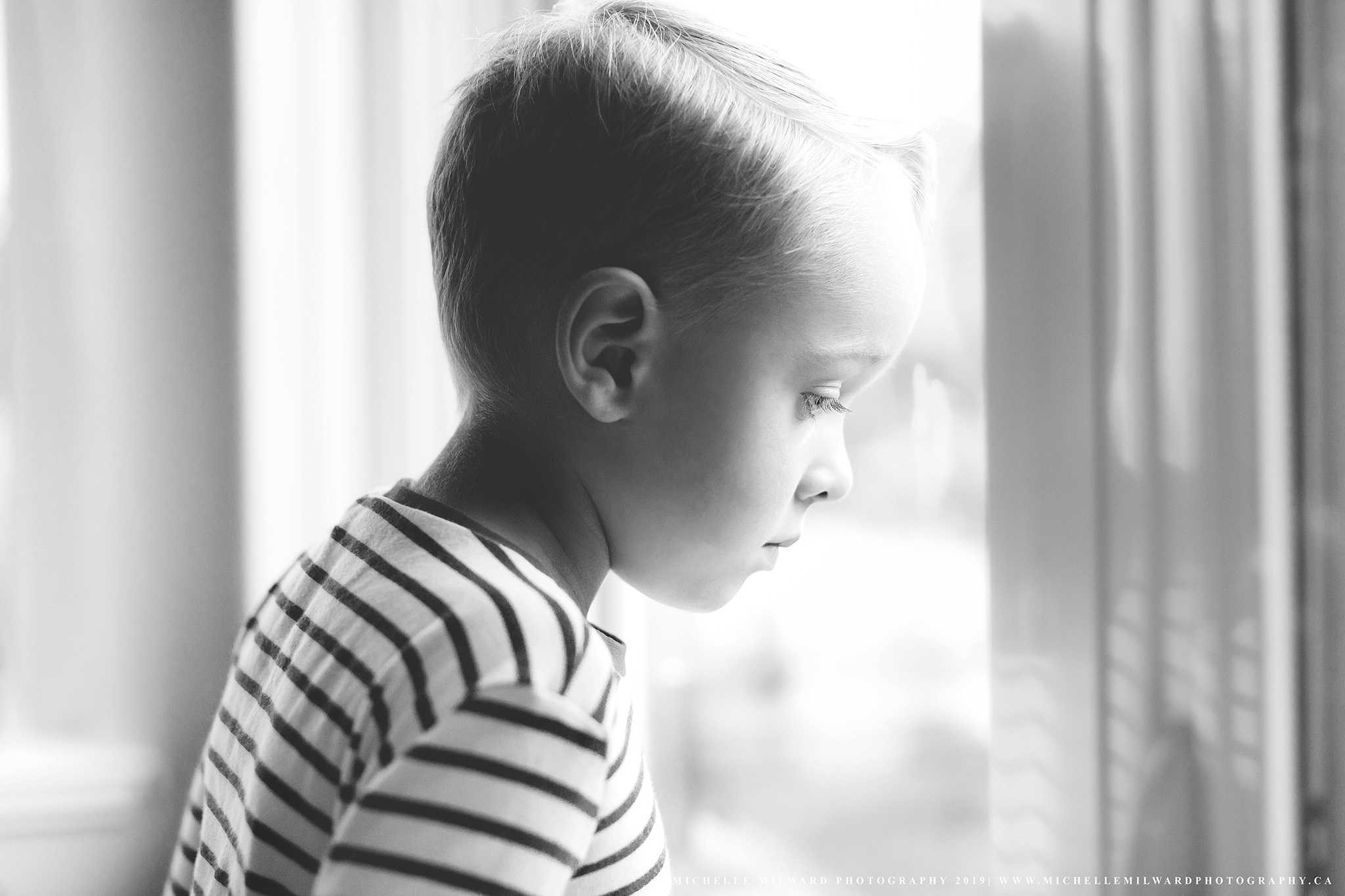 My son looking out the window from our Mount Washington Condo | 2019