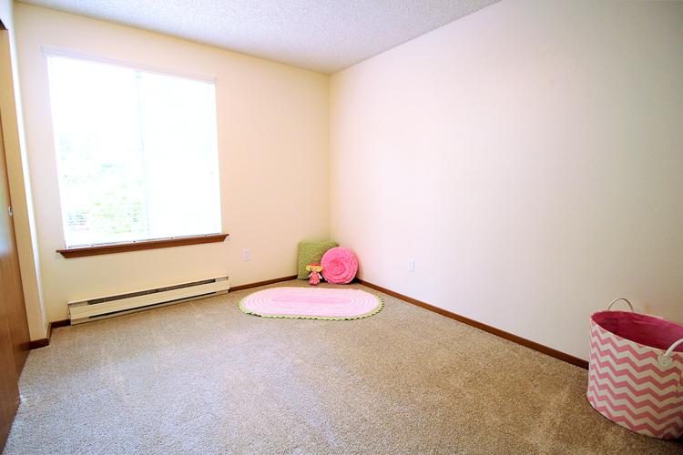 benson-village-apartments-small-bedroom.jpg