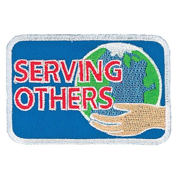 The GA Serving Others Badge - This badge is earned by GAs who participated in the Birthday Box Project.