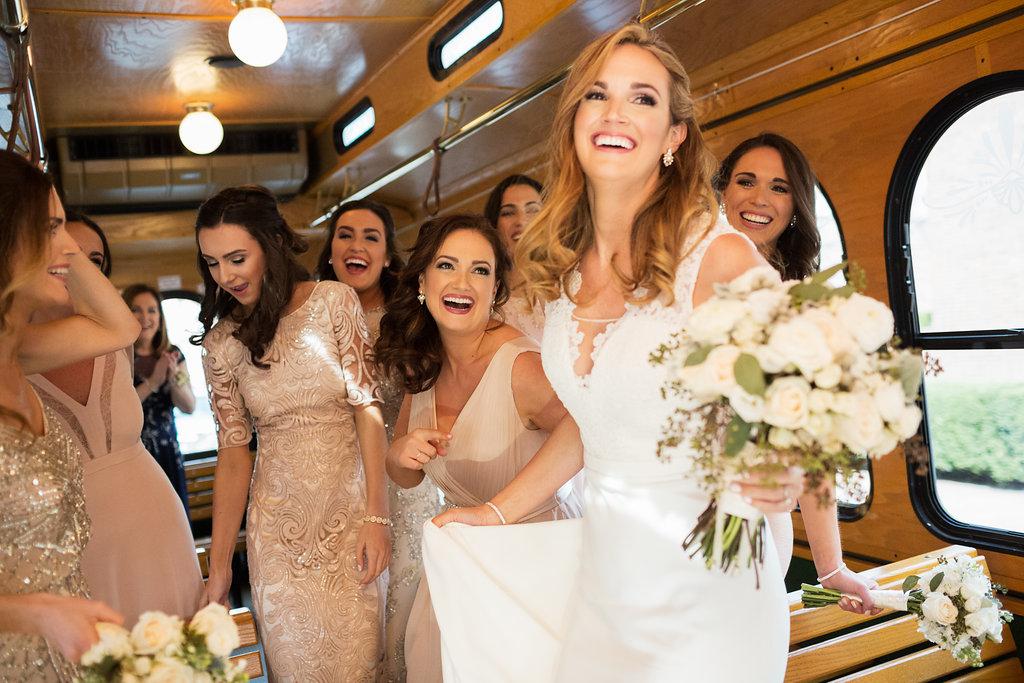 Trolley inside bridesmaids laughing @divzimedia.jpg