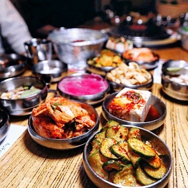 """The beauty of Baekjeong is that you get an array of beautiful looking """"banchan"""" (side dishes) that have distinct flavors: sweet, spicy, tangy, sour, savory, and umami. Mix and Match every bite to create different flavors! #koreanbbq #baekjeongnyc #kbbq #ktown #meat #usdaprime #koreanfood"""