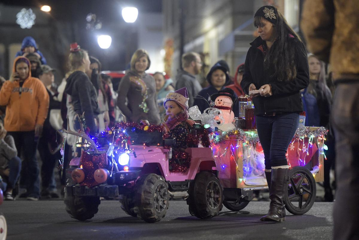 Ava Andrews, 4, navigated her way through Albany's Downtown Twice Around Parade with her mother, Felicia.  (2019 DH Mark Ylen).jpg