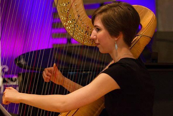 Susanna playing the Harp.