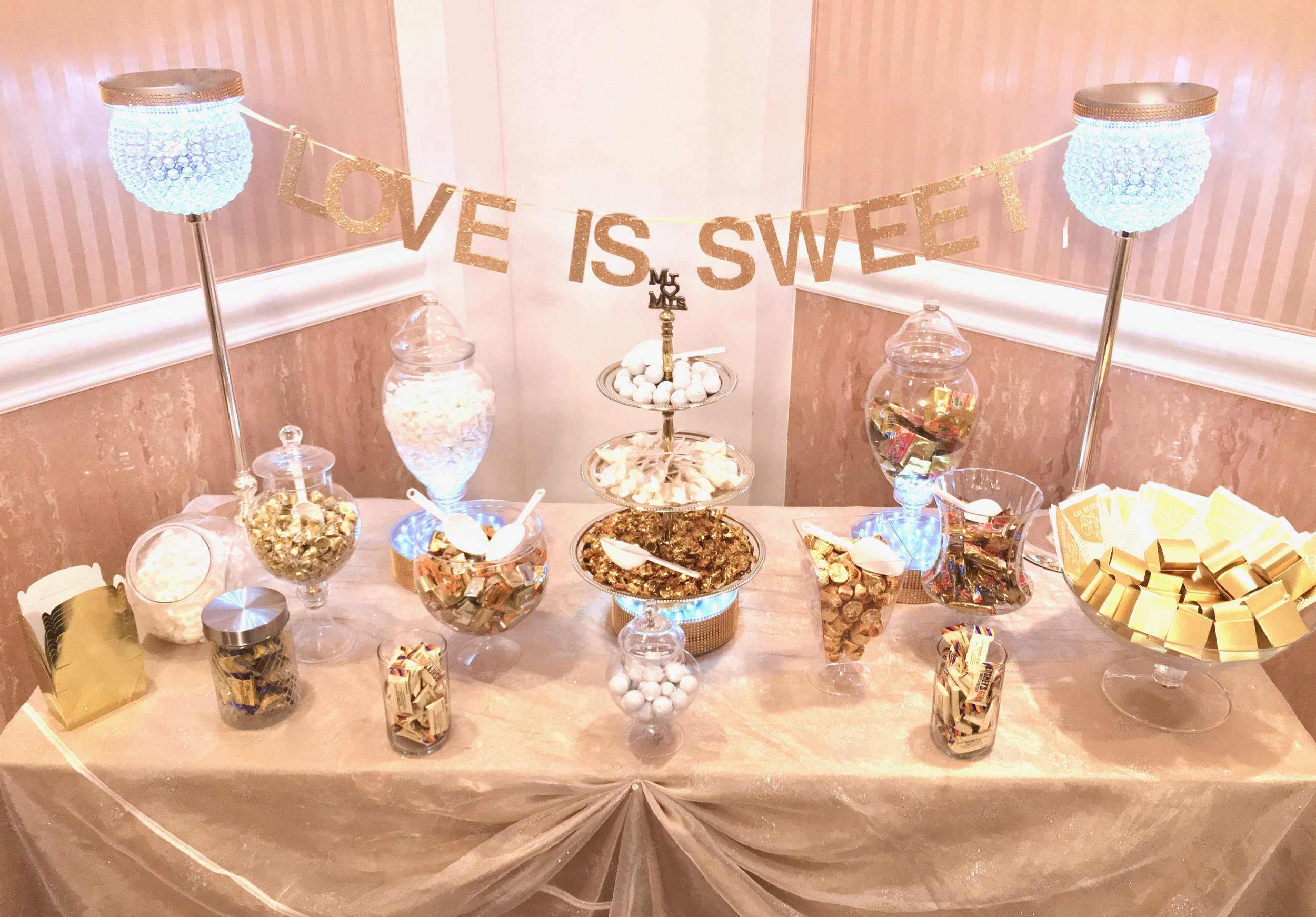 - An assortment of candies, chocolates, and confectionaries coordinated with your color scheme. Complete with gift boxes, goodie bags, and optional lighting.