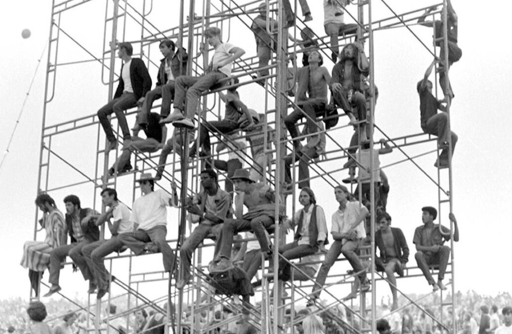 Fans at Woodstock chilling on scaffolding.  Credit:  Getty Images /  Esquire