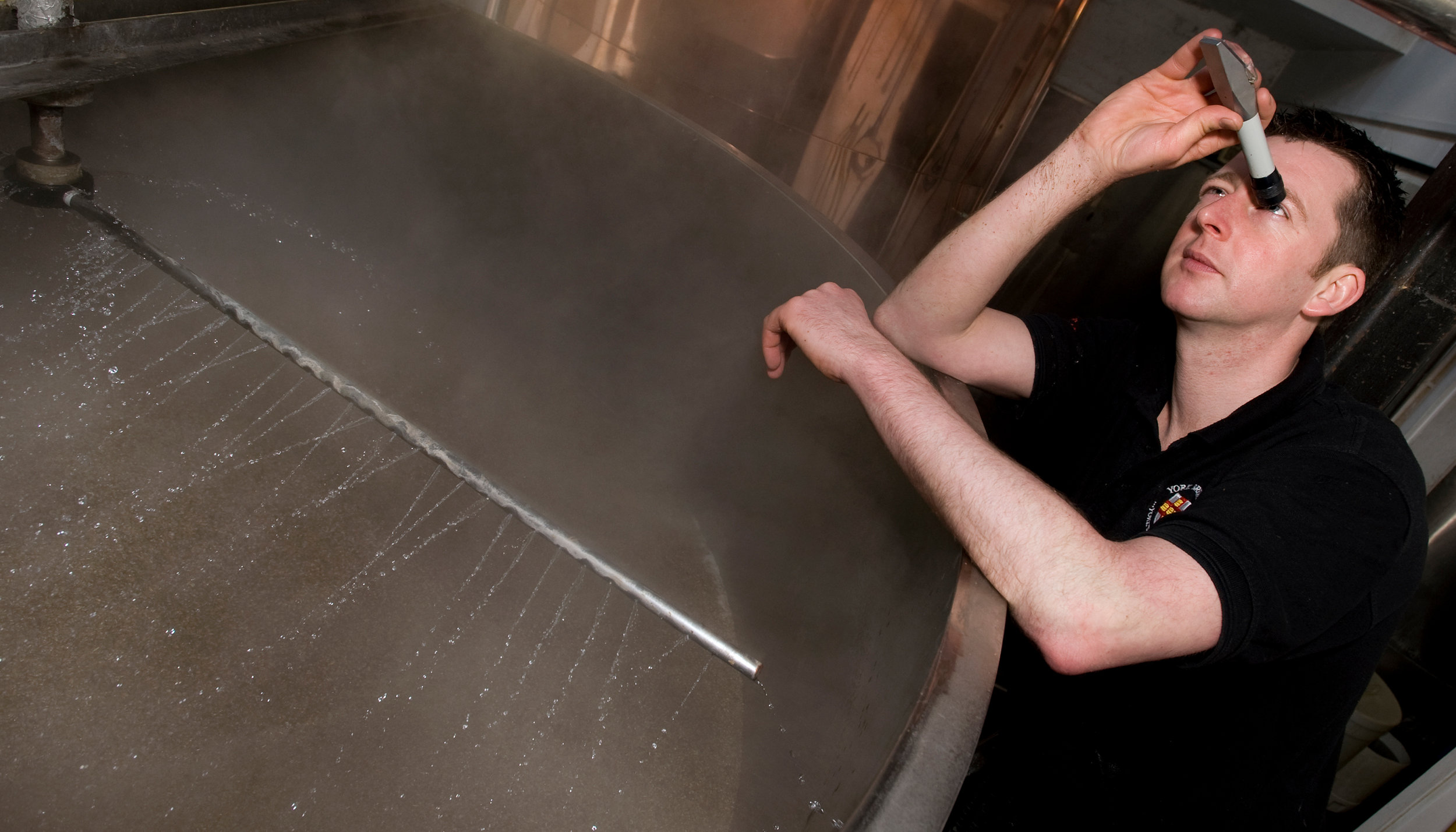 York Head Brewer Nick Webster performs checks on a batch of beer brewed at Toft Green.