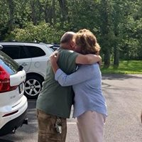 Embrace after a car was donated to single father - life changing day!