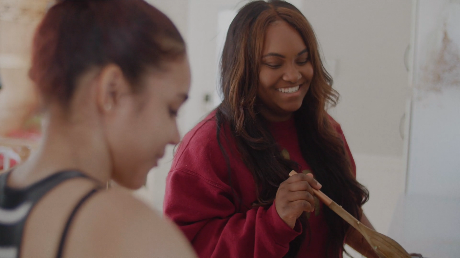 A screencap of Karmen with her former client Emmie    in our recent video    about Emmie's work with CFCS