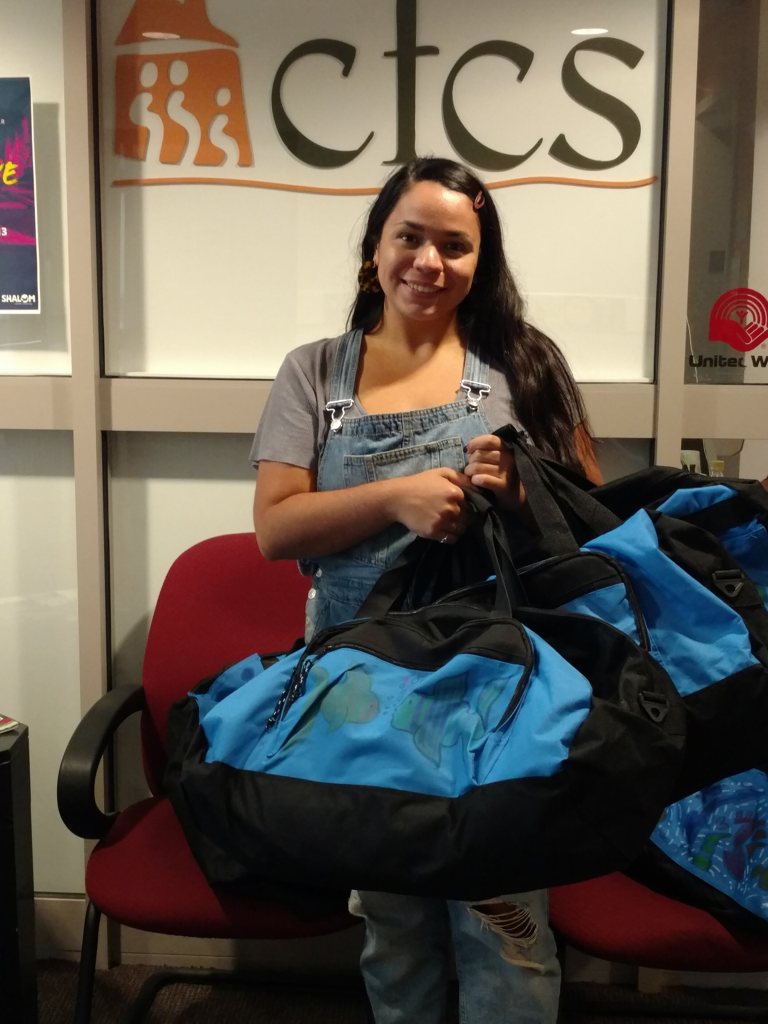 Family Support & Stabilization Coordinator Andrea Ruiz, picking up Sweet Cases for families