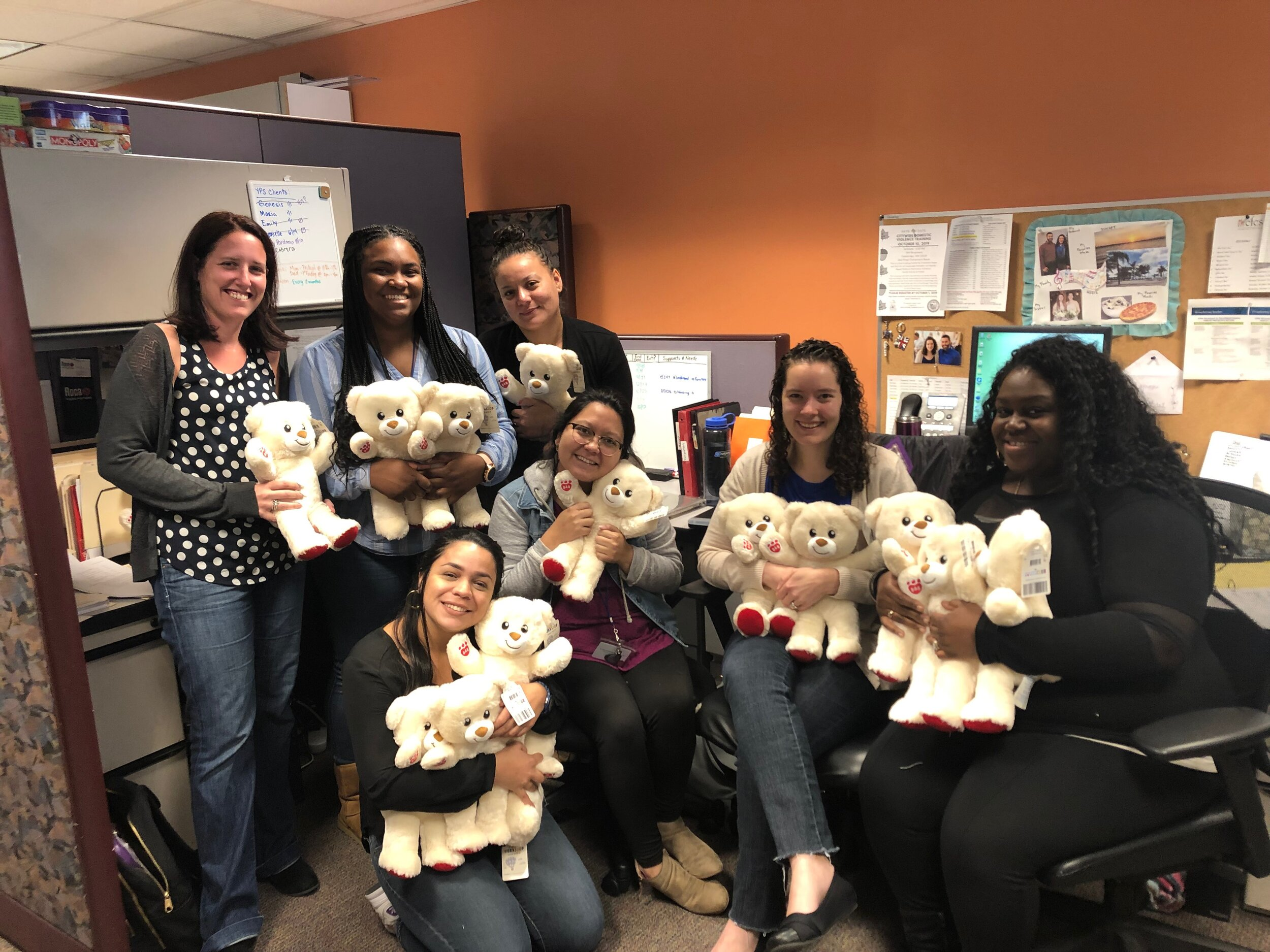 The Family Support & Stabilization team, with bears that will soon go to good homes.