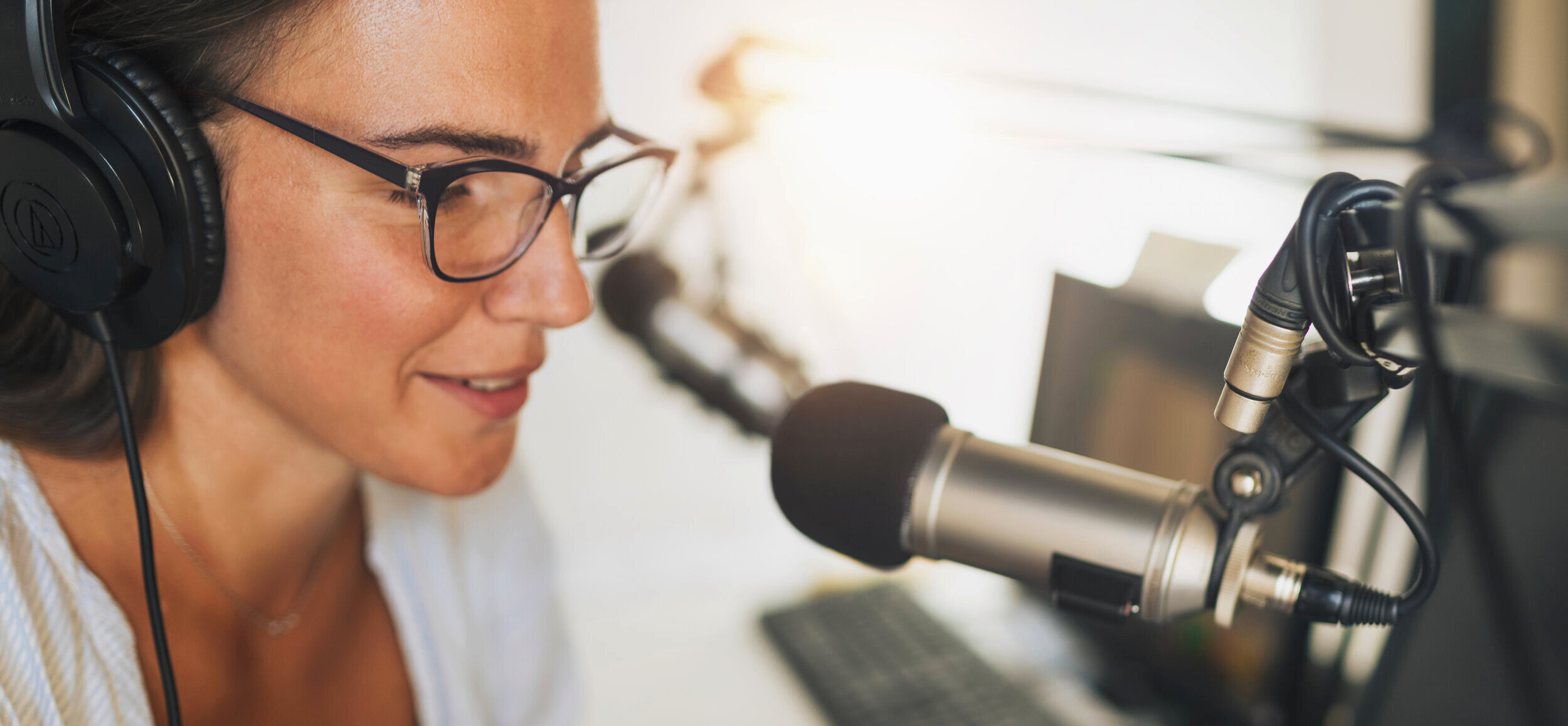 Podcast-Lady+talking+into+microphone