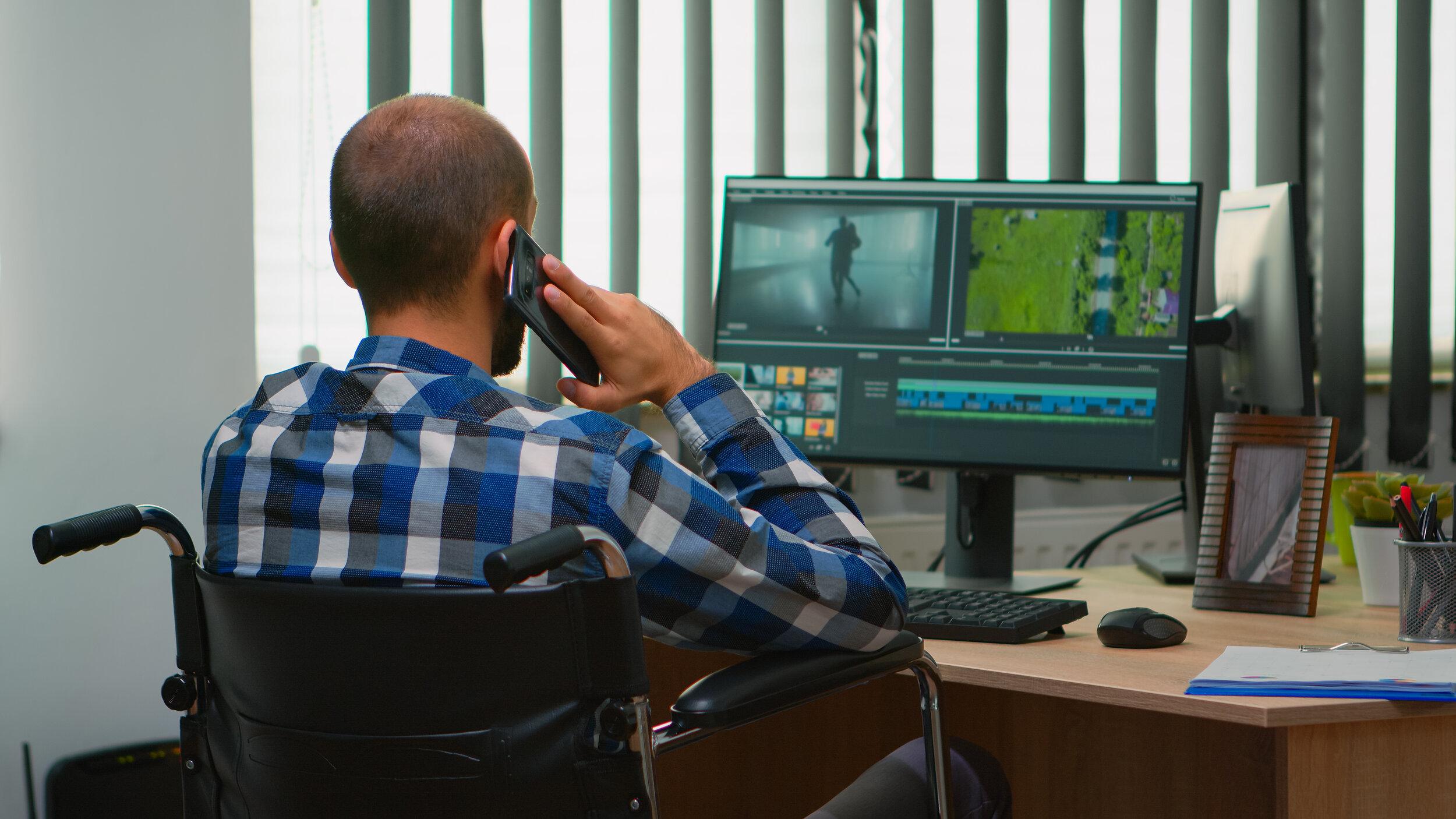 disabled-freelancer-videographer-talking-on-phone
