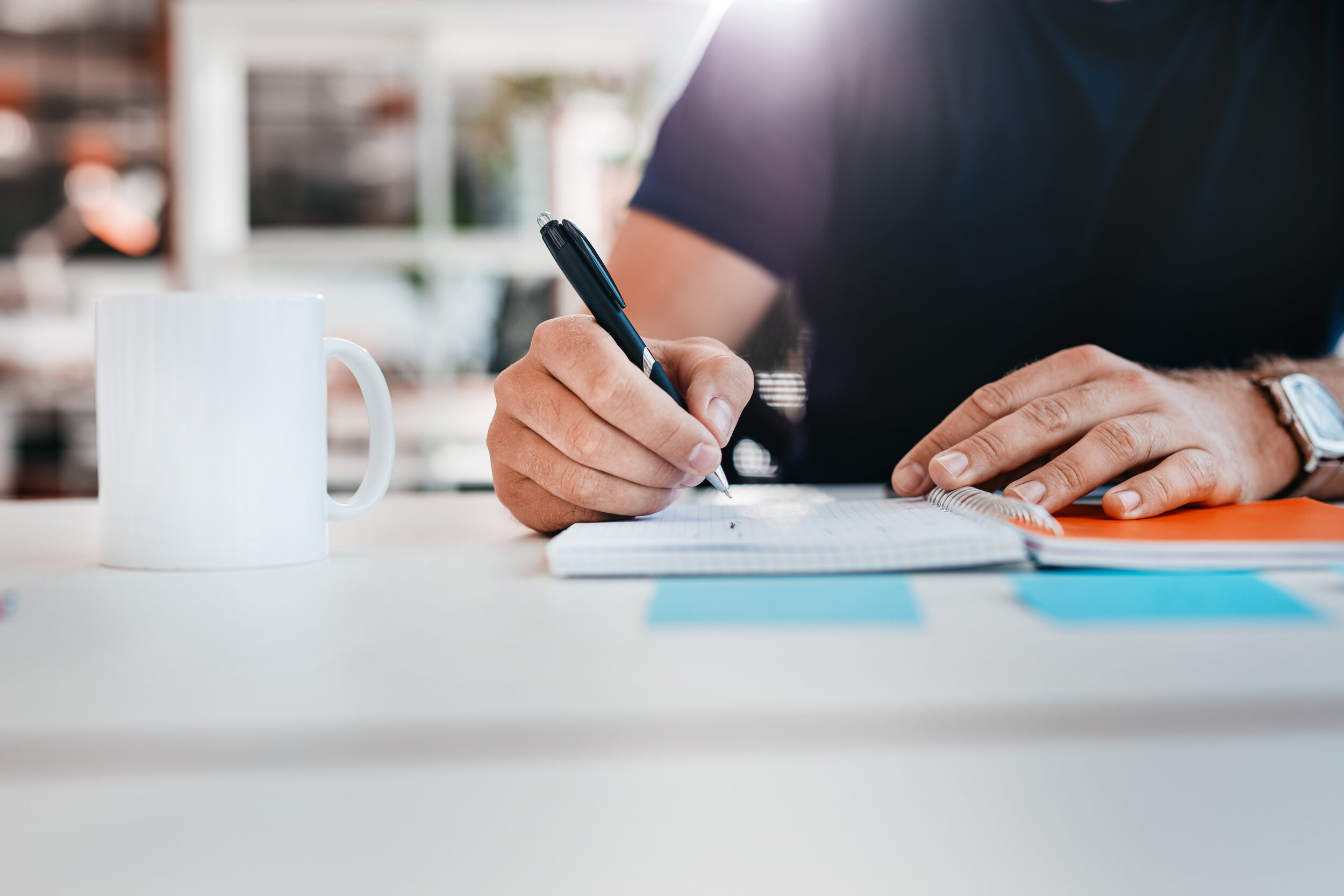 businessman-hands-writing-notes