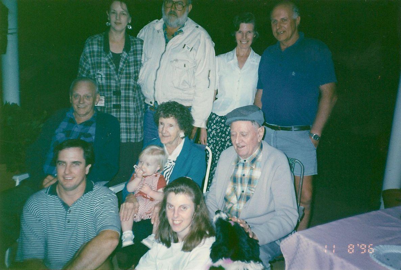 "Back row L-R:   Barbara & Brian Bell, Jane & Brian Collett.   Centre row L-R:   Harry (""Grumps"") & Mollie Baldwin (holding me), Colin Bell.   Front row L-R:   David & Megan Bell."