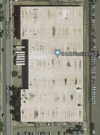 An aerial view of the damaged roof at B&R Plastics' warehouse. We efficiently secured attractive C-PACE financing for the $1.4 million roof replacement.