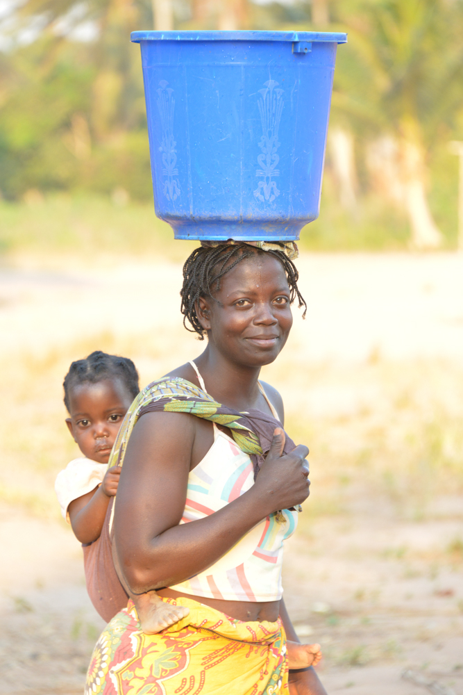 women with baby carring water-.jpg