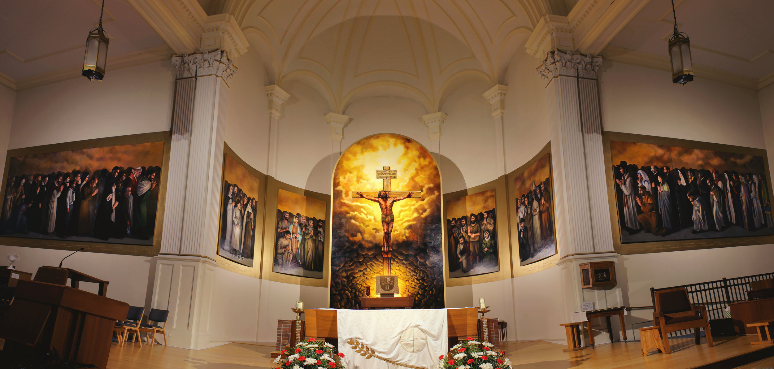 "Communion of Saints  (720x108"") and  The Crucifixion  (120x240"") are commissioned acrylic murals painted on canvas and panel, created for the sanctuary of St. Anne Church of  All Saints Parish , Alpena, MI in 2016-18. After a 2015 merging of the four independent parishes which make up All Saints Parish, the artworks were commissioned as a unifying architectural design element. They consist of a central depiction of the crucifixion and 62 life-size portraits of saints, including the four patron saints of the former parishes (St. Anne, St. Bernard, St. John the Baptist, and St. Mary, the Immaculate Conception)."