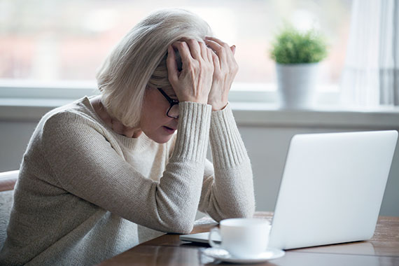 frustrated-Middle-aged-Woman-In-Front-Of-computer.jpg