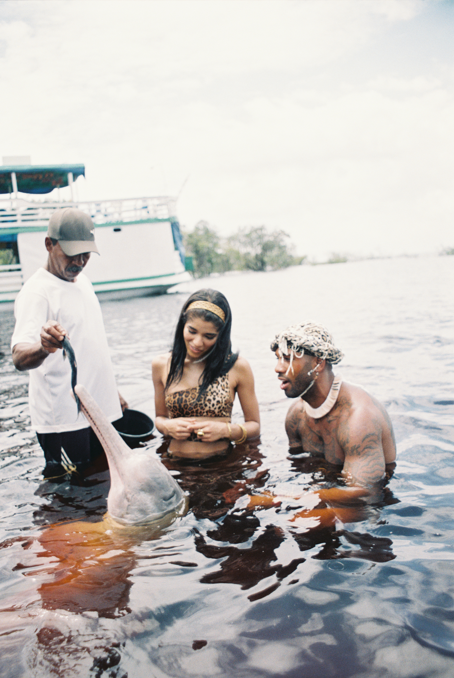 Yovanna and Mike Holston with a pink river dolphin  Photo by Amber Asaly