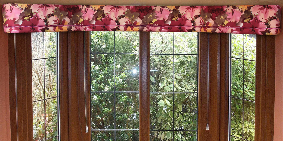 Why not change and enhance your bay window for the different seasons. This bright, lovely flowered fabric reminds us of spring and summer.