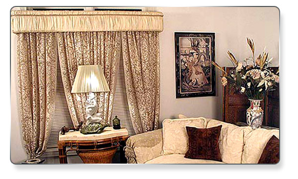 Gathered Fabric just tucked into the Top Banana Cornice to give this rich look with matching trim.