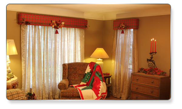 We wrapped stripped material on the cornices for the fall and winter season. We quickly changed the look for spring and summer to a light flowered printed material. At Christmas we decorated the cornices with a beautiful Xmas plaid material and added Christmas trim and decorations.