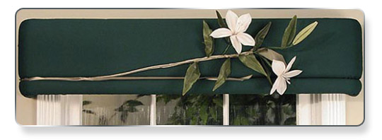 Just pin on one elegant lily on dark green fabrics — dramatic!
