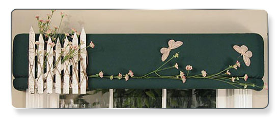 For the more daring home-decorator, a white picked fence with flowers poking their blooms through… on dark green cotton fabric to stand out.