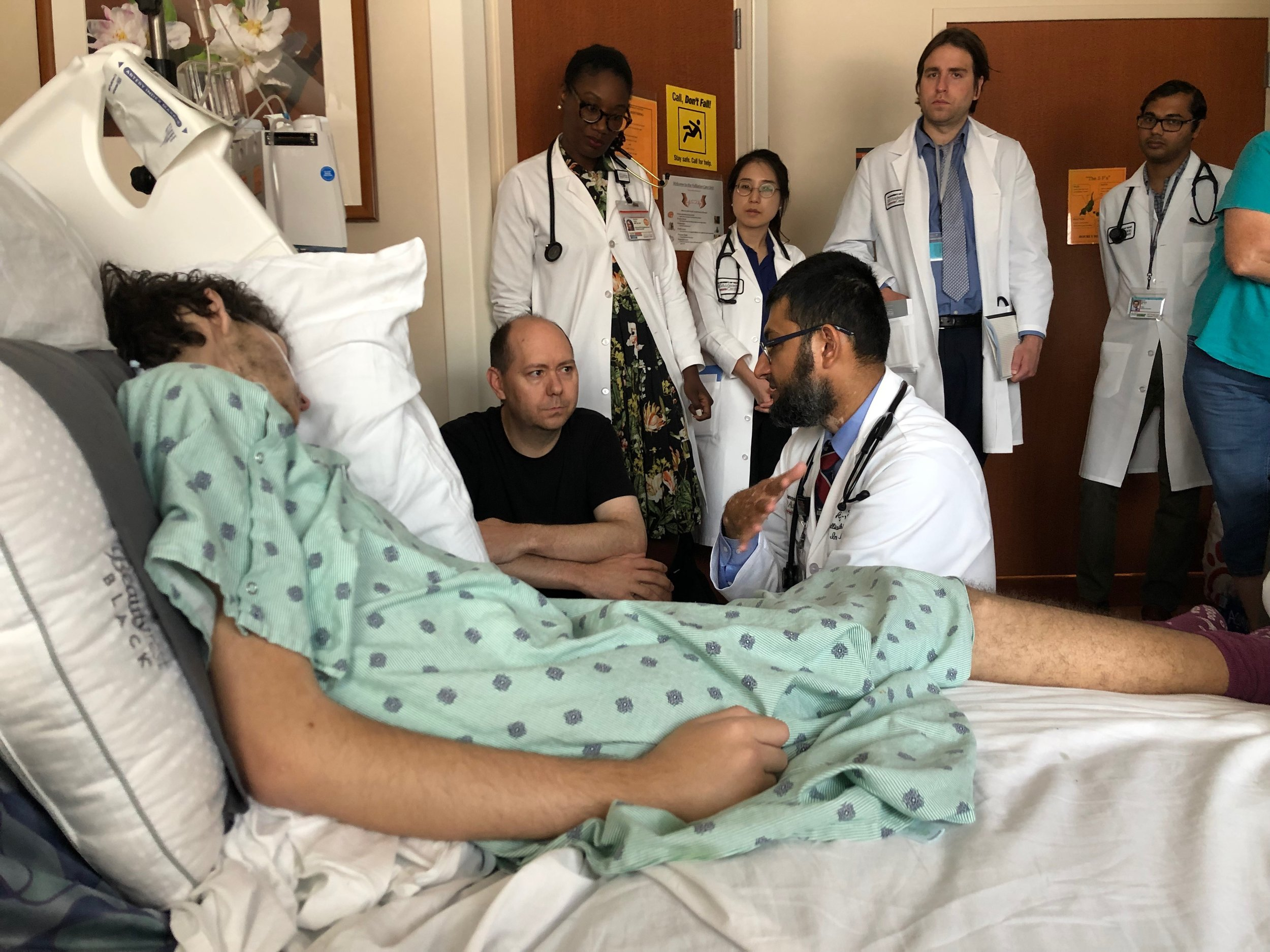 Me in my typical spot, right next to Shawn's bed, with some of Shawn's medical team at MD Anderson.
