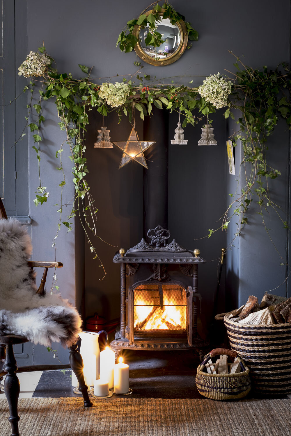 Cosy Christmas fireplace with wood burning stove and holly and i